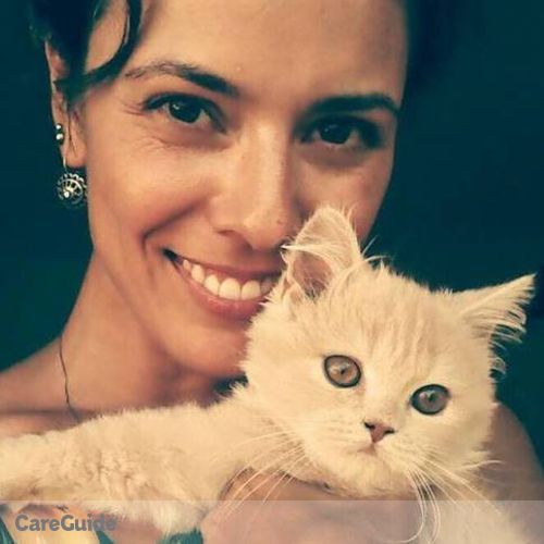 House Sitter Provider Caína Oliveira's Profile Picture